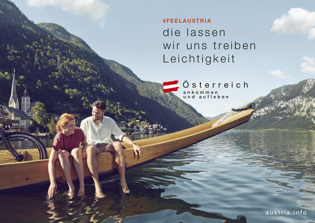 bergsee-boot-paar-sommer-oesterreich
