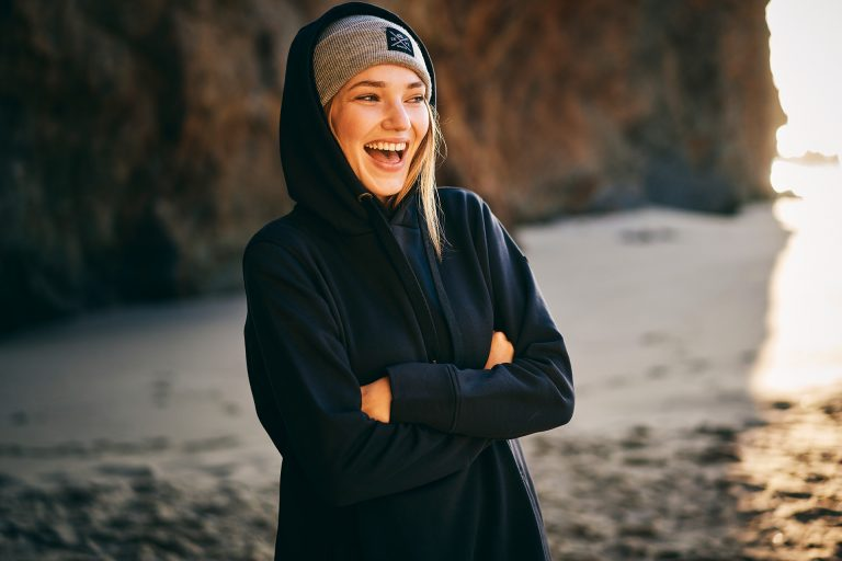girl-beach-laughing-hoodie-campaign