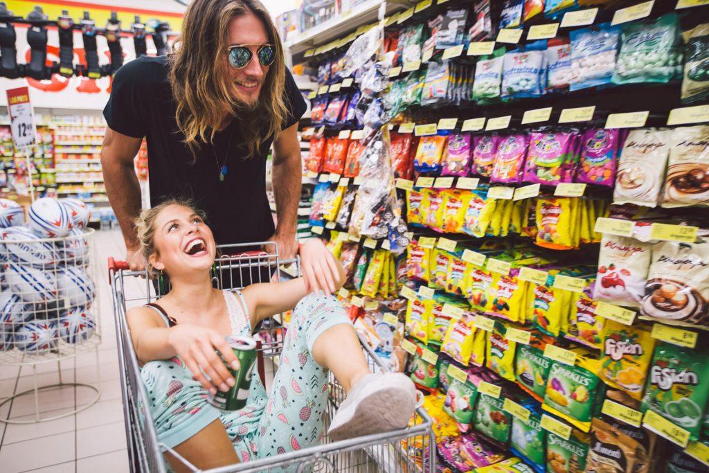 supermarket-fun-couple-basket-buying